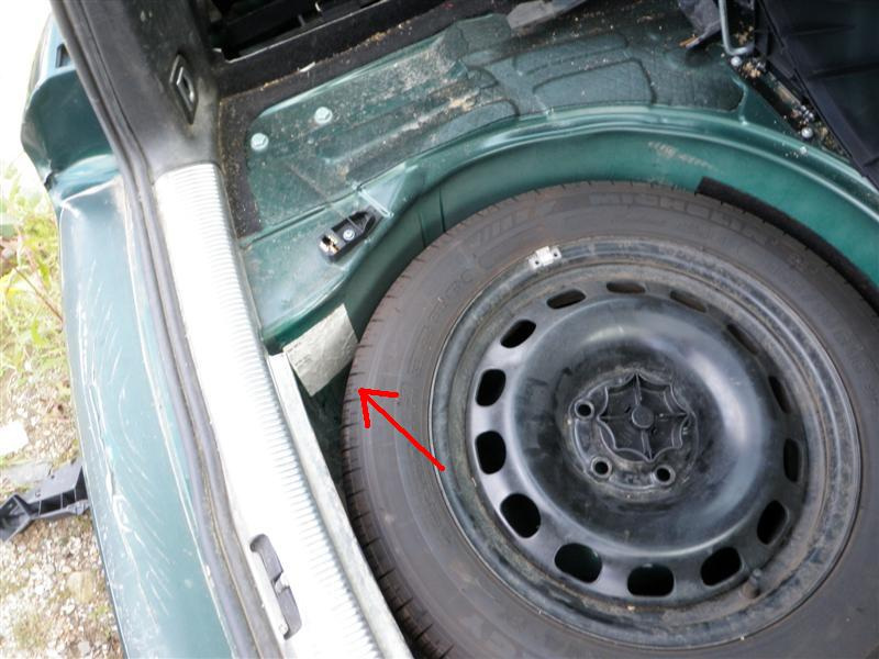 What you may not have noticed is that sticker peeking out from behind the spare tire.  Not exactly the first place you might look when trying to find a paint code.